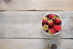 Raspberries in bowl on wooden table. Top view Stock Images