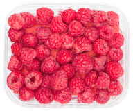 Raspberries in Box Top View. Top view of raspberries in a plastic box isolated on white with path Royalty Free Stock Photo