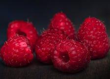 Raspberries on a bunch macro shot stock image