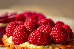 Raspberries on a cake stock photography