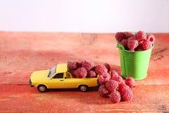 Raspberries in a car Stock Photo
