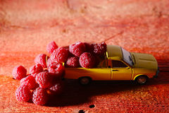 Raspberries in a car Royalty Free Stock Photos