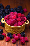 Raspberries in ceramic bowl Royalty Free Stock Photography