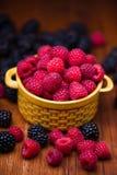 Raspberries in ceramic bowl Stock Photos