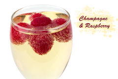 Raspberries in champagne glass isolated on a white background. Selective soft focus Royalty Free Stock Photography
