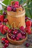 Raspberries, cherries and strawberries Stock Images