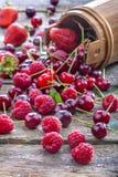 Raspberries, cherries and strawberries Stock Photos