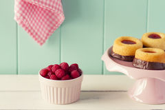 Raspberries and chocolate cakes Stock Photos