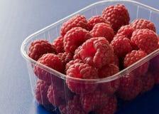 Raspberries. Close up of fresh raspberries in plastic box Royalty Free Stock Photos
