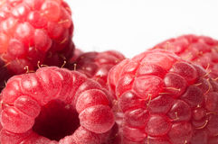 Raspberries close up isolated. On a white background Stock Photography