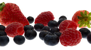 Raspberries, cranberries, strawberries Stock Photography