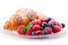 Raspberries and Croissant. Berries and Croissant on a plate Royalty Free Stock Image