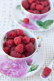 Raspberries In Cups Stock Photo