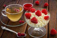 Raspberries on curd Royalty Free Stock Images