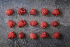 Raspberries on the dark stone background Royalty Free Stock Images