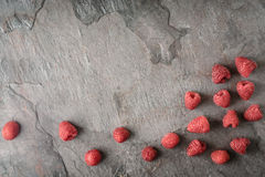 Raspberries on the dark stone background  top view Royalty Free Stock Images