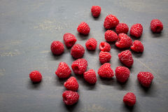 Raspberries. On a dark table Stock Photography