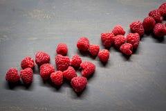 Raspberries. On a dark table Stock Photos