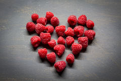 Raspberries. On a dark table Royalty Free Stock Images