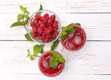 Raspberries drink. Raspberries drink on a white wooden table Stock Images