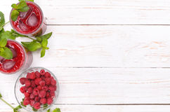 Raspberries drink. Raspberries drink on a white wooden table. Frame. Background Royalty Free Stock Image