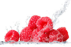 Raspberries falling in water. Fresh raspberries falling in water Royalty Free Stock Photography