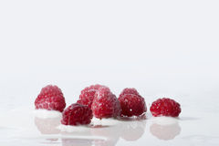 Raspberries Falls Into Milk Royalty Free Stock Photography