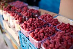 Raspberries on a farm market in the city. Fruits and vegetables at a farmers summer market. Raspberries on a farm market in the city. Fruits and vegetables at a Royalty Free Stock Photography