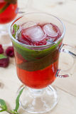Raspberries fresh drinks with ice and mint on wooden table. Selective focus Royalty Free Stock Photos