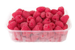 Raspberries. Fresh raspberries in the plastic box over white background Royalty Free Stock Image