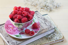 Raspberries. Fresh raspberries in porcelain cup stock images
