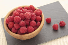 Raspberries. Fresh raspberries in a wooden bowl Royalty Free Stock Photos