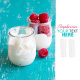Raspberries and fresh yogurt in a jar. On a turquoise background Royalty Free Stock Image