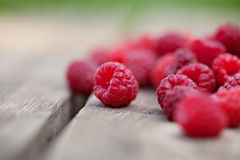 Raspberries fruits. Rasperries fruit on wooden background outdoor Royalty Free Stock Image