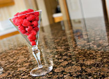 Raspberries in a glass Royalty Free Stock Image