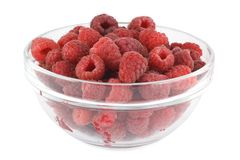 Raspberries in a glass bowl. Isolated on white Royalty Free Stock Images
