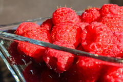 Raspberries in a glass bowl. Close up of raspberries in a glass bowl Stock Photo
