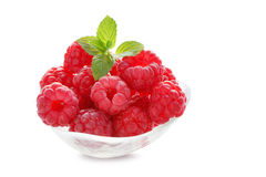 Raspberries in glass bowl isolated on white background. Fresh raspberries in glass bowl isolated on white background Royalty Free Stock Images