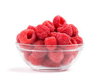 Raspberries in a glass bowl. On white Royalty Free Stock Photography