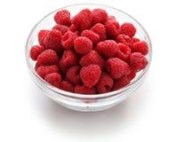 Raspberries in glass bowl Stock Photos