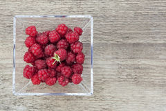 Raspberries in a glass bowl. Stock Image