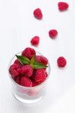 Raspberries in the glass Stock Photos