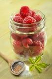 Raspberries in glass jar Stock Images