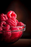 Raspberries. In glass jar on dark background Stock Images