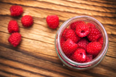 Raspberries in a glass jar Stock Image