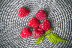 Raspberries on a gray background Royalty Free Stock Images