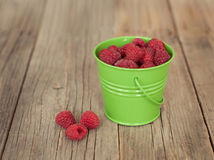 Raspberries in a green bowl Royalty Free Stock Photos