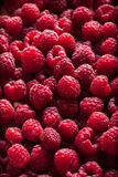 Raspberries group in box on dark background. Raspberries fresh group in box on dark background Stock Image