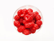 Raspberries. Isolated wineglass with raspberries on white background Royalty Free Stock Image