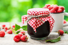 Raspberries jam and fresh berries on table Royalty Free Stock Images